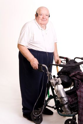 Man carrying portable oxygen for his COPD