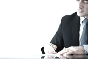 Man signing a letter