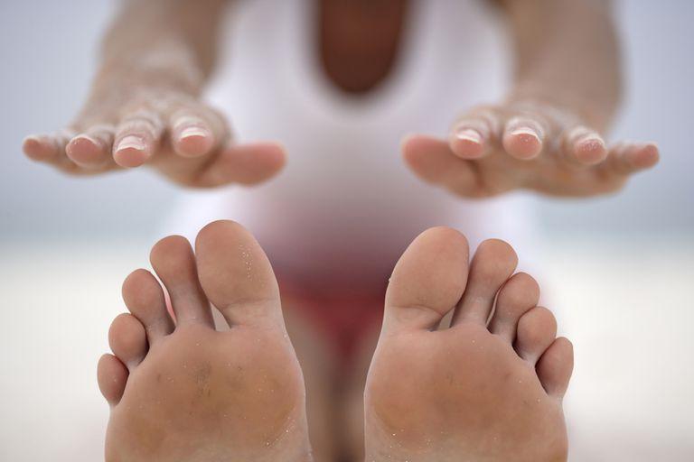 Hands reaching toward toes