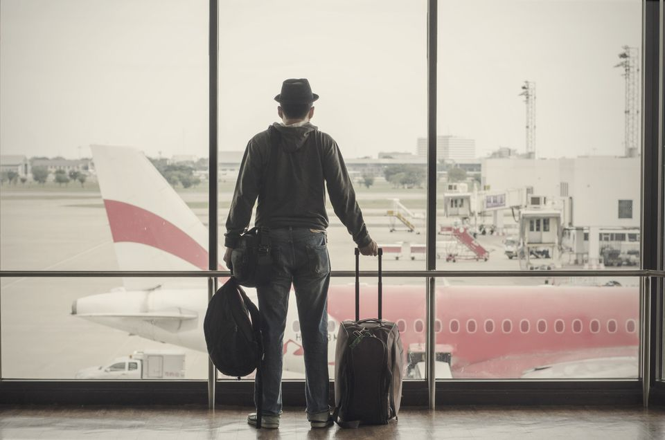 Man standing with luggage at the airport