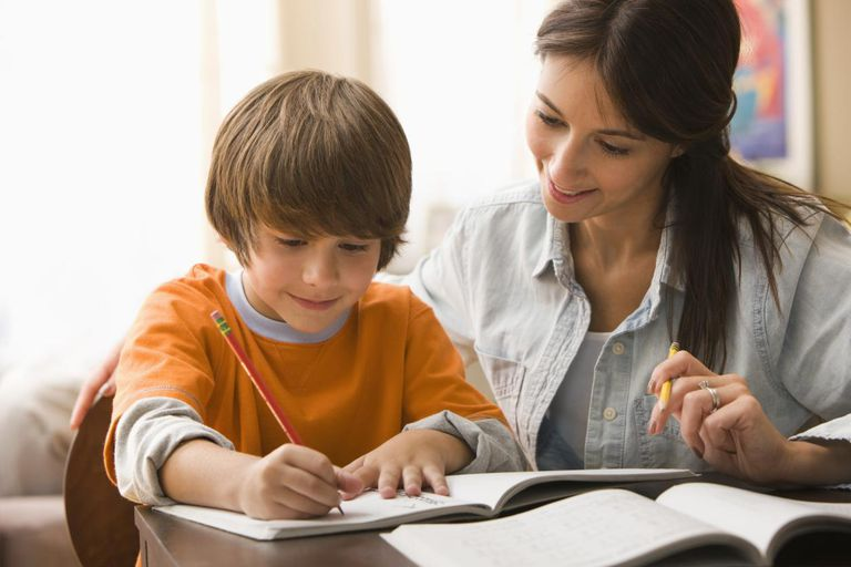 Caucasian mother helping son with homework