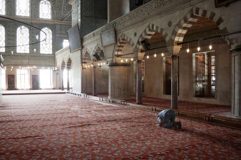 Old man praying in the Sultan Ahmed mosque