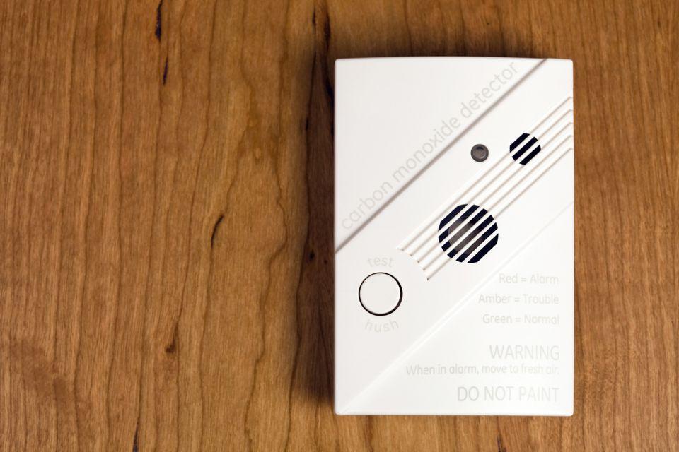 Carbon Monoxide Detector on Cherry Wood