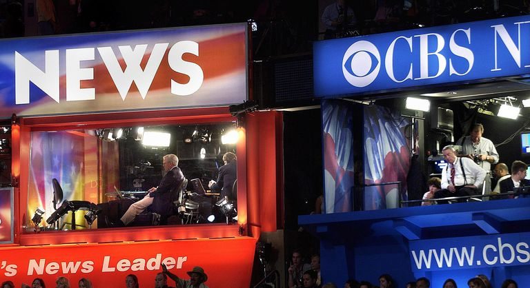 A photo of the NBC and CBS broadcast booths at a political convention