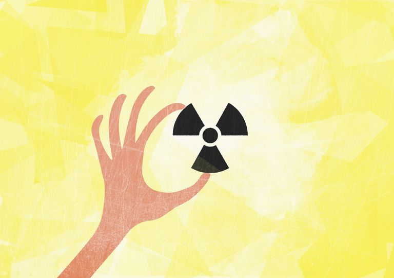 illustration of hand reaching for radioactive symbol