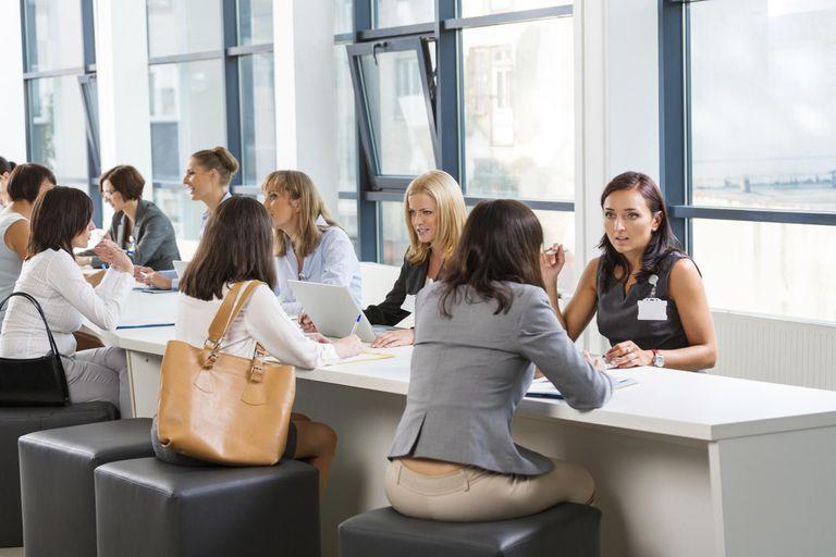 Job fair Group of women attending a job fa...