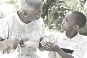 grandmother handing money to grandson