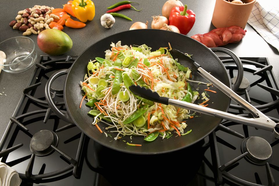 Vegetables in wok on hob