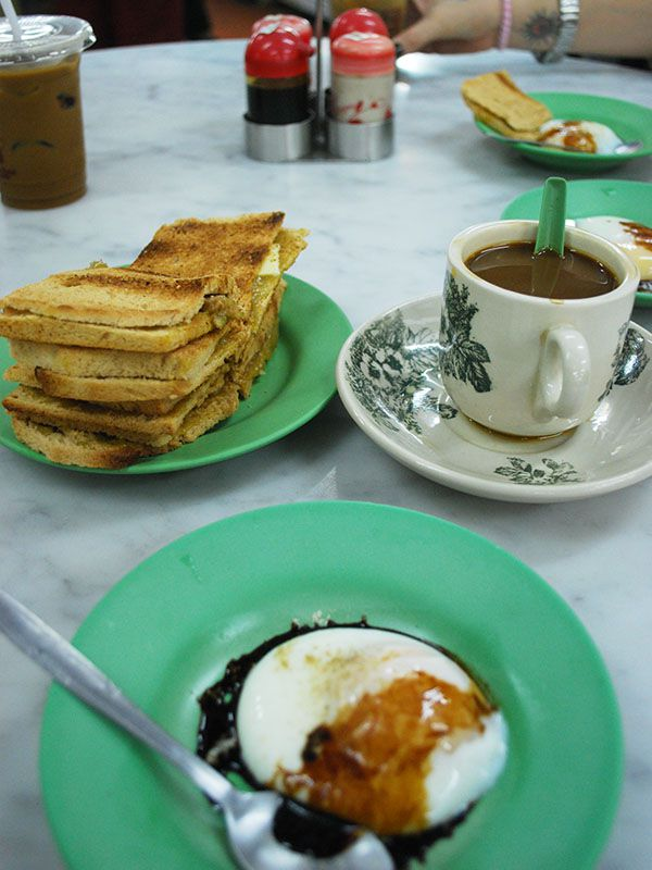 Roti kaya, coffee and poached egg in Ya Kun Kopitiam, Singapore