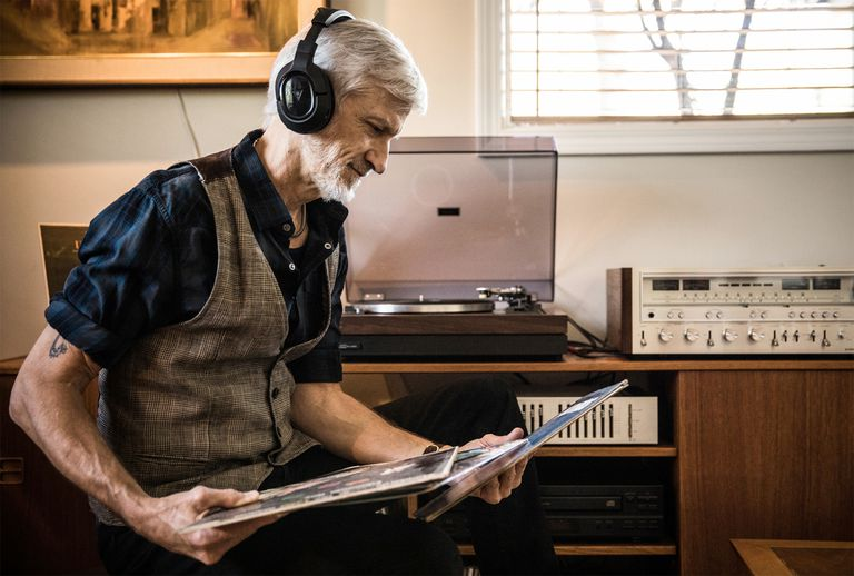 Man Listening to Vintage Stereo Setup