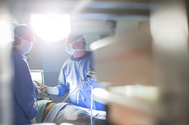 Physicians in the operating room performing surgery