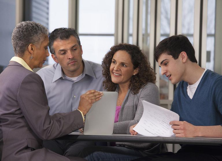 Parents and son talking with financial advisor