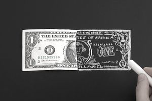 Drawing dollar bill on chalkboard