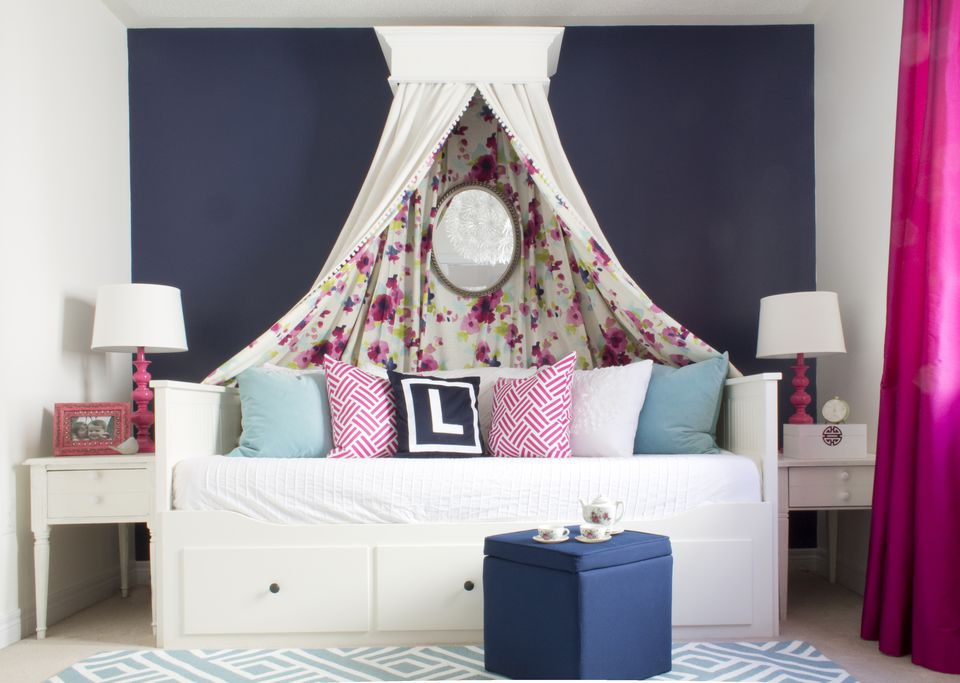 Modern girl's room with floral-print bed canopy