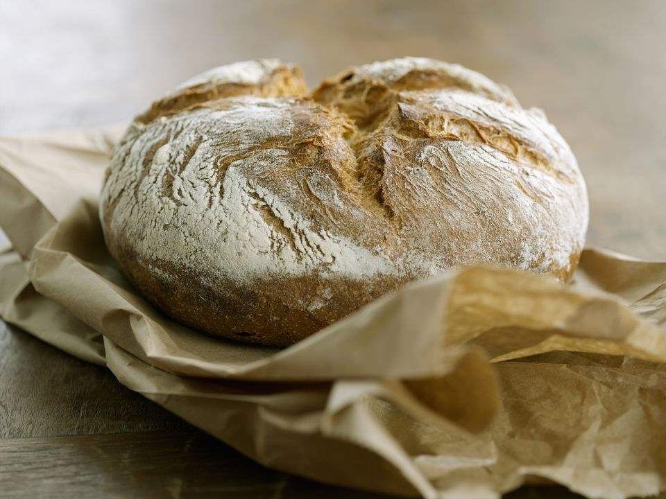 Rustic Loaf of Potato Bread on Brown Paper Bag