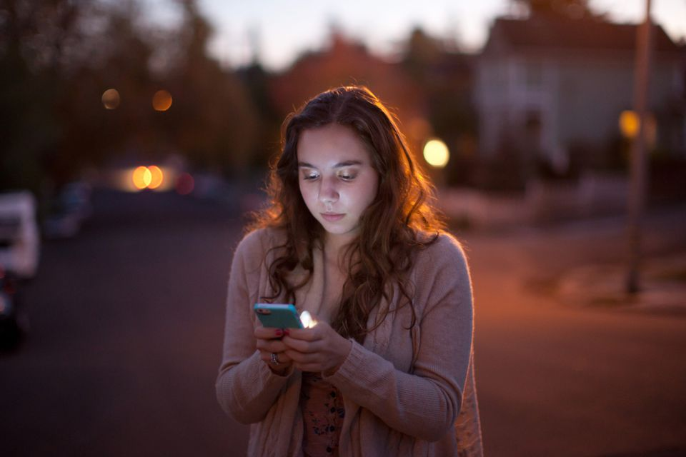 Girl at night on cellphone