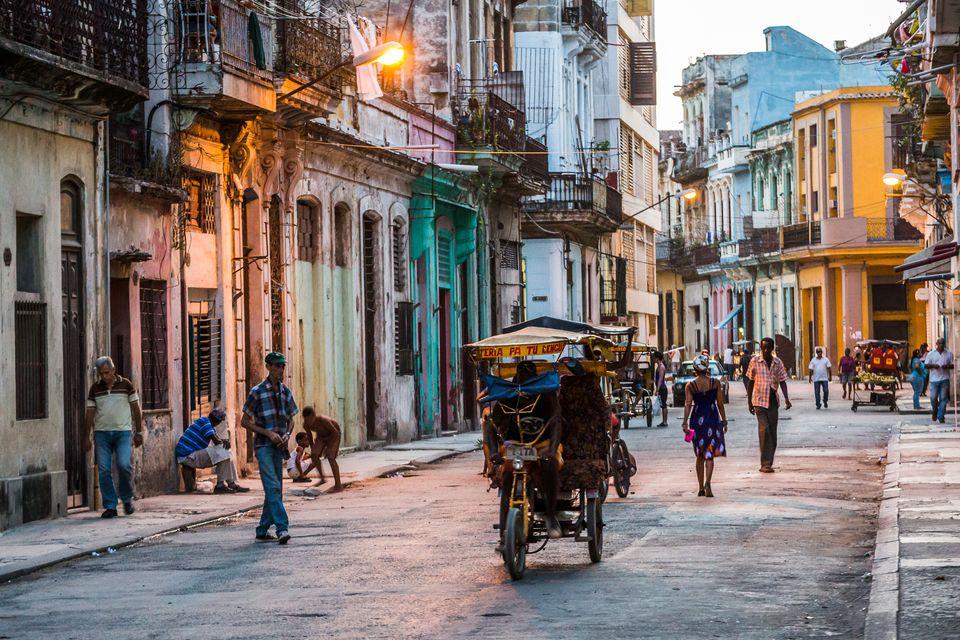 Bicitaxi down a backstreet in Havana at dusk