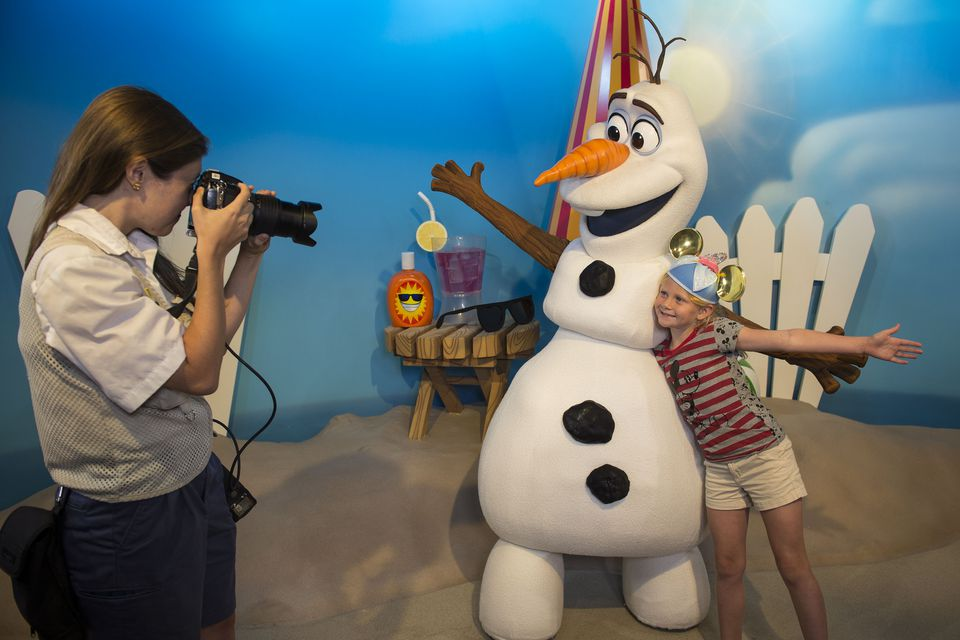 Young girl poses with Olaf at Disney's Hollywood Studios