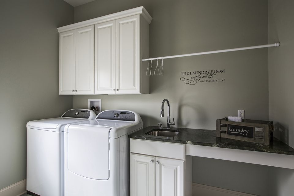 Washing machine, dryer and sink in laundry room