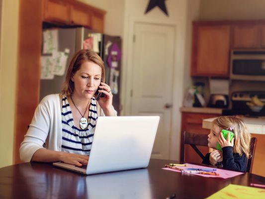 Woman having a serious business phone conversation