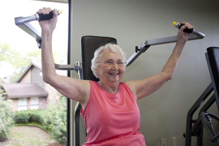 An elderly woman working out.