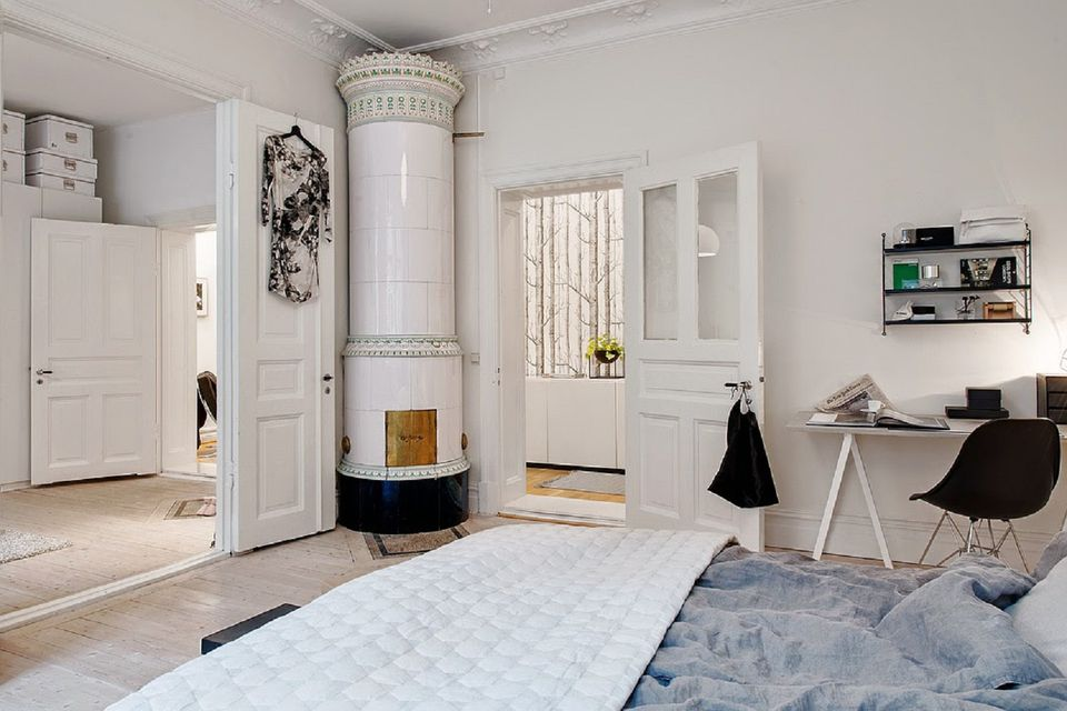 Scandinavian Bedroom With Fireplace