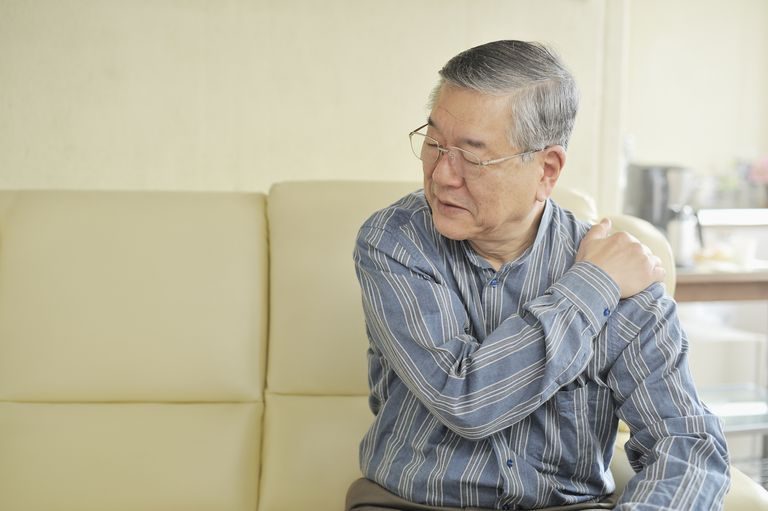 Senior man holding his shoulder