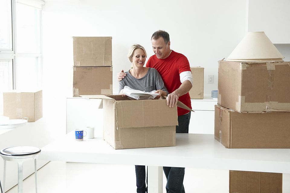 Couple packing up their home to move