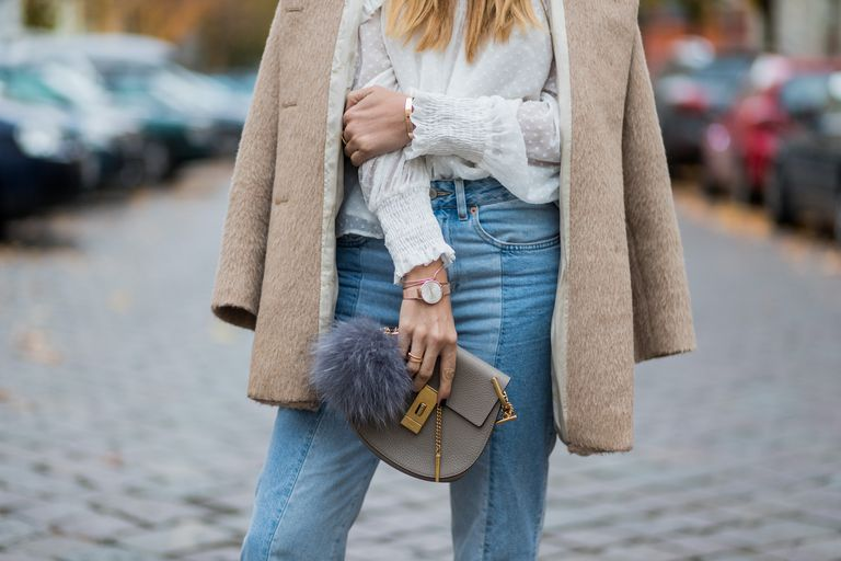 Street style woman in jeans and a coat
