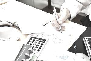 Business paperwork planning calculation messy desk