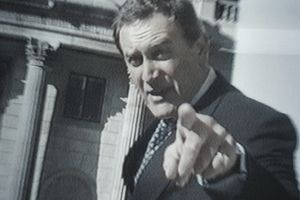 A photo of a politician pointing into a TV camera.