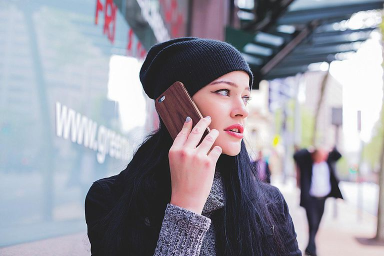 concerned woman talking on cell phone