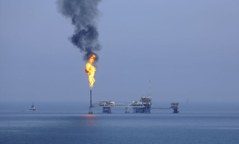 Burning gas in oil field in Gulf Sea.