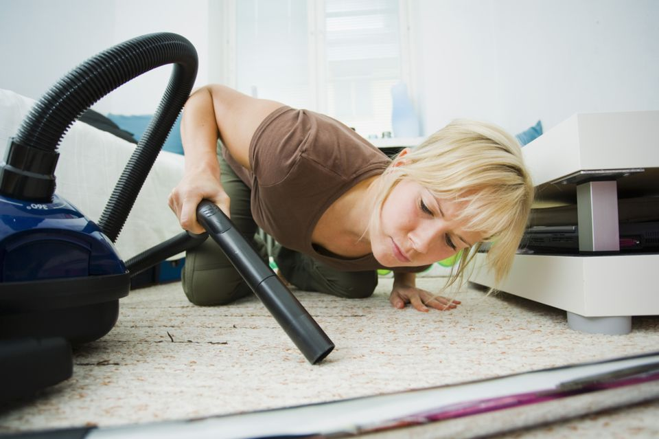 Woman cleans the apartment floor