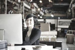 Smiling businesswoman sitting at workstation