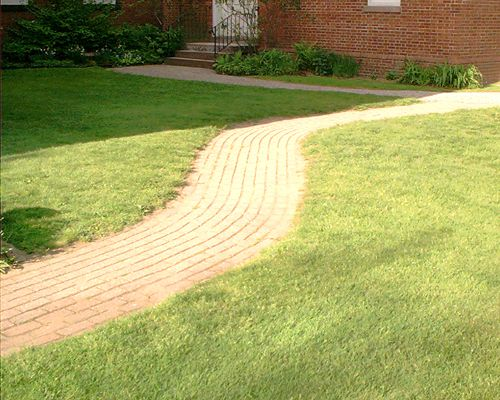 Picture of a curved brick walkway.