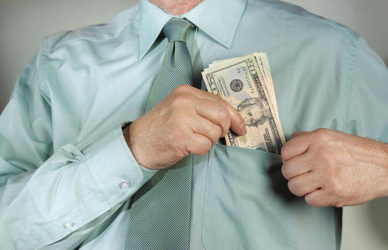 Man putting tax refund money in his shirt pocket.