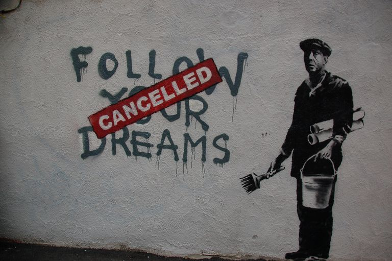 Street art by Banksy suggesting that society has made it impossible to follow one's dreams reflects the struggles that face inner city youth.