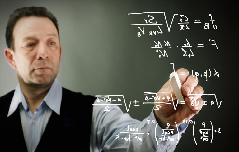 Businessman writing formulas