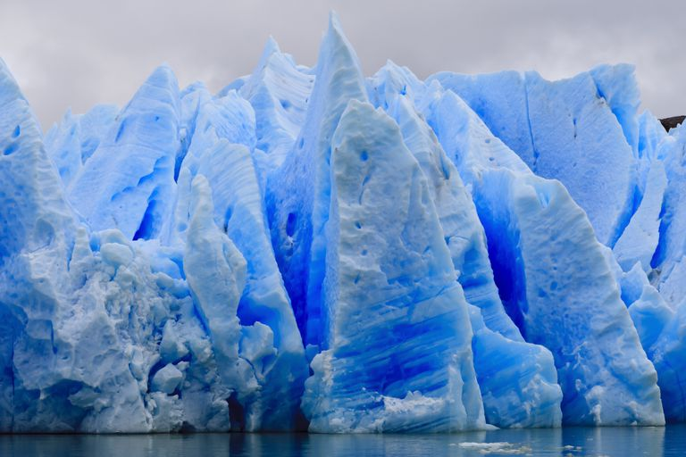 The blue ice of Grey Glacier at Torres del Paine National Park in Chile is blue because there aren't bubbles in it to scatter light.
