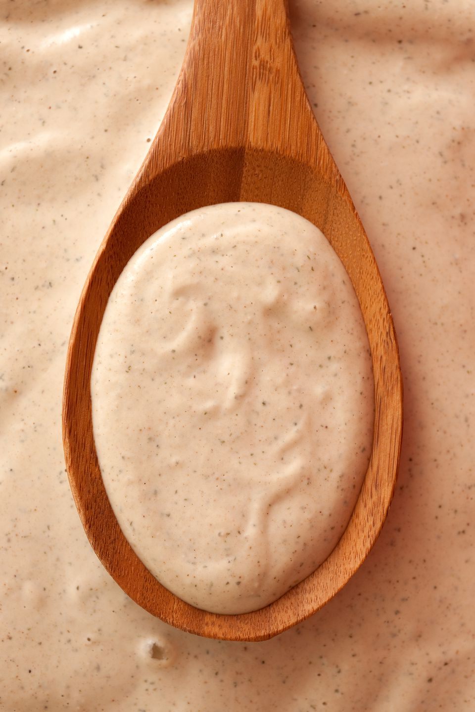 Tahini on a wooden spoon
