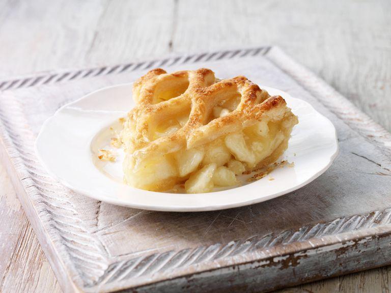 Brambly apple pie slice on wooden chopping board
