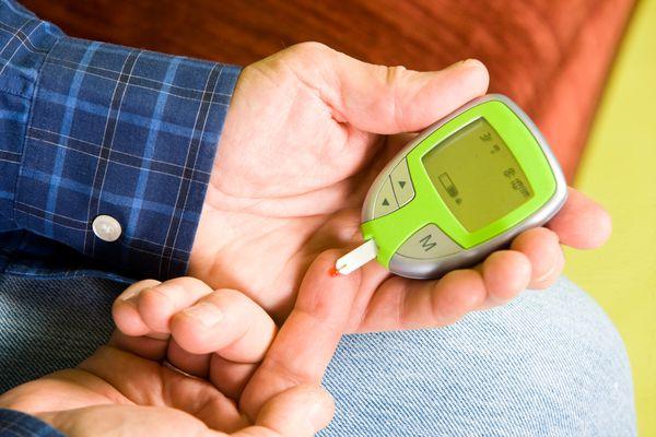 Man checking blood sugar