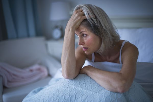 Woman Wide Awake in Bed