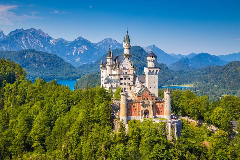 Famous Neuschwanstein Castle with scenic mountain landscape near