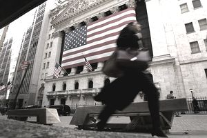 Woman walks past NYSE