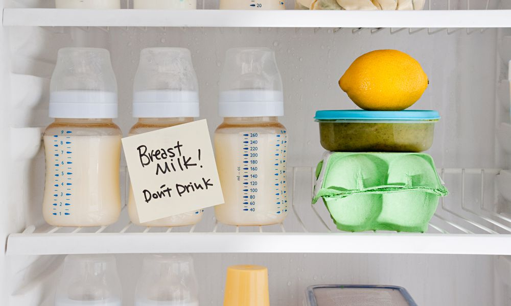 "Bottles of breast milk in the refrigerator with sign ""Don't Drink"""