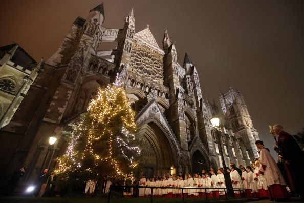 Choristers of Westminster Abbey stand as a 25 foot Christmas Tree is illuminated