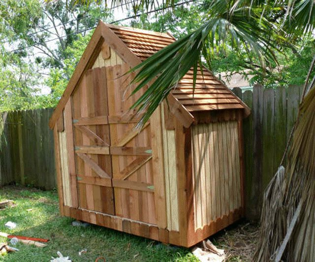 a narrow wooden shed in a backyard - Garden Sheds Wooden