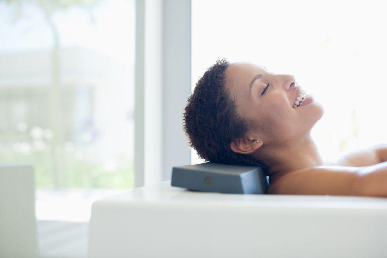 Smiling woman in bathtub